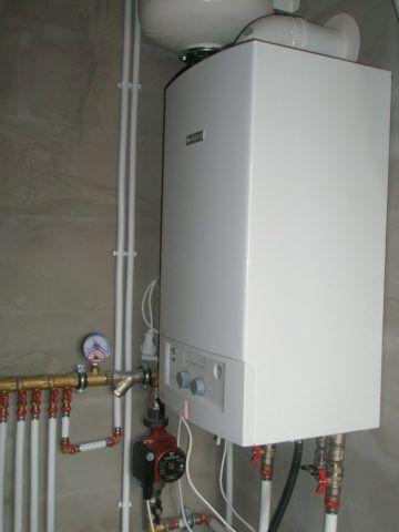 Газовый котел привязан к дымоходу, вентиляции или внешним стенам дома